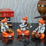 3 Ganesha Playing Musical Instruments Decorative Showpiece 12.7 cm  (Polyresin, Orange, Brown)